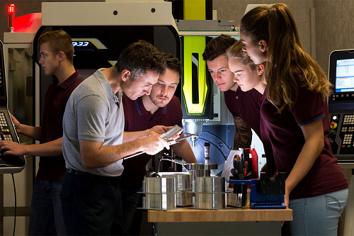 Photograph of students working collaboratively on a manufacturing project