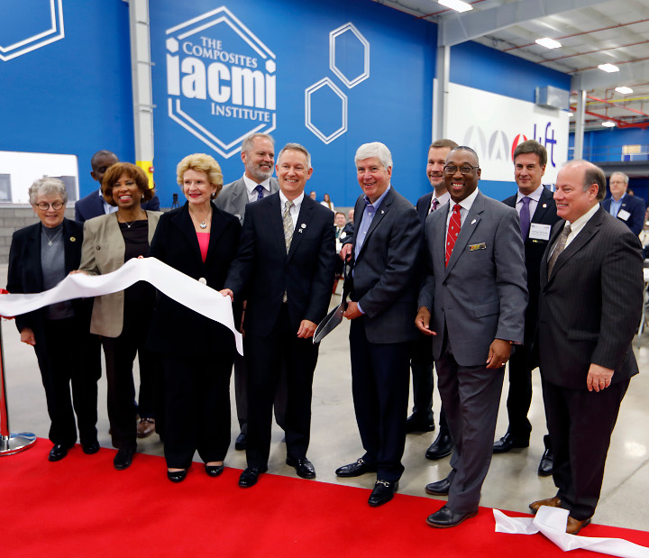 Photograph of (from left): Michigan State University President Lou Anna K. Simon, Office of Naval Research Program Manager Johnnie Deloach, Congresswoman Brenda Lawrence, Senator Debbie Stabenow, Dir. of the IACMI Vehicle Scale Up Facility Ray Boeman, IACMI Interim CEO John Hopkins, Michigan Governor Rick Snyder, Deputy Dir. of the Dept of Energy Adv. Manufacturing Office Rob Ivester, LIFT Executive Dir. Lawrence Brown, LIFT Technology Development Committee Chair Jeffrey Nichols, & Detroit Mayor Mike Duggan.
